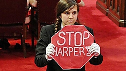 Brigette DePape protests during the Senate throne speech in 2011. Source: CBC.